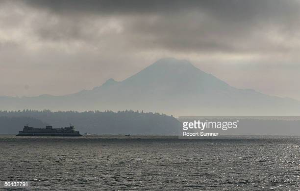Washington State Ferry bound for Seattle passes Mt Rainier in Washington's Puget Sound December 14 2005 in Seattle Washington Teams of undercover air...