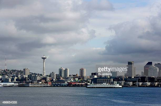 A Washington State Ferry traverses past the city skyline through Puget Sound as seen from the Vigor Shipyard in Seattle Washington US on Friday April...