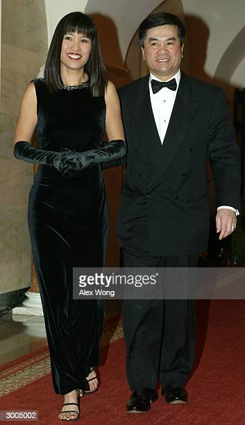 Washington State Governor Gary Locke and his wife Mona arrive for a dinner hosted by President George W Bush and first lady Laura Bush February 22...