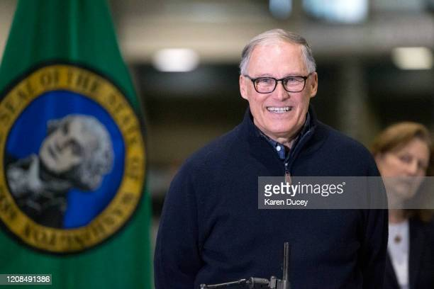 Washington State Governor Jay Inslee and other leaders speak to the press on March 28 2020 in Seattle Washington The governor discussed deployment of...