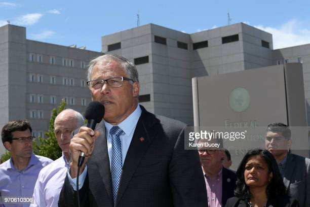Washington state Governor Jay Inslee joined by many other government officials speaks at a press conference outside a Federal Detention Center...