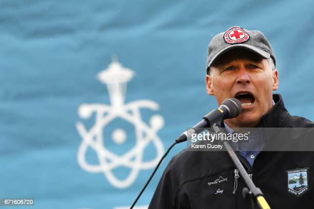 Washington state Governor Jay Inslee speaks at a rally during the March for Science at Cal Anderson Park on April 22 2017 in Seattle Washington...