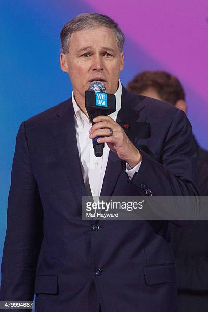 Washington State Governor Jay Inslee speaks on stage during We Day at Key Arena on March 21 2014 in Seattle Washington