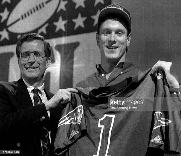 Washington State junior quarterback Drew Bledsoe holds up a jersey after being picked number 1 overall in the first round by the New England Patriots...