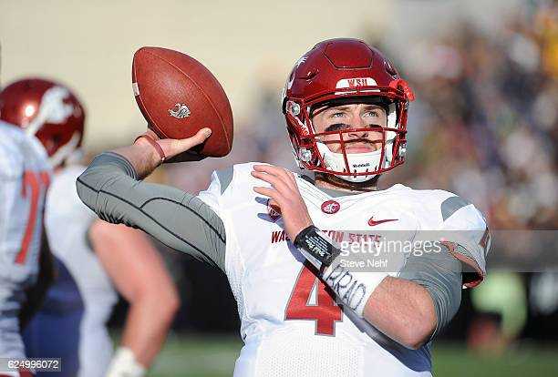 Washington State quarterback Luke Falk stays loose on the sidelines during an injury timeout in the second quarter against the University of Colorado...