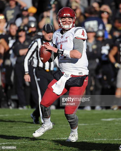 Washington State quarterback Luke Falk throws a quick pass to the sideline in the second quarter against the University of Colorado at Folsom Field...