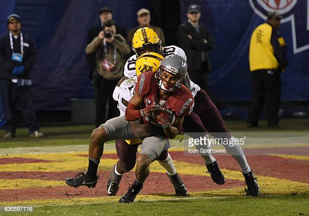 Washington State Robert Lewis catches the ball against Minnesota Zo Craighton and Minnesota Eric Amoako but fails to break the plane of the endzone...