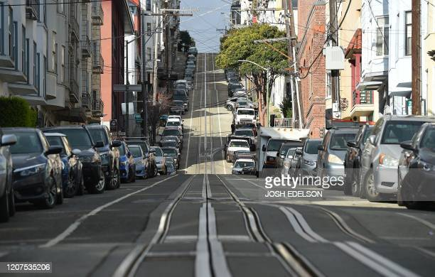 Washington Street usually filled with iconic cable cars is seen mostly empty in San Francisco California on March 17 2020 Millions of San Francisco...