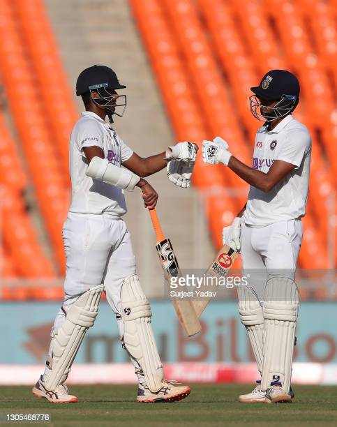 Washington Sundar and Axar Patel of India interact during Day Two of the 4th Test Match between India and England at Sardar Patel Stadium on March...