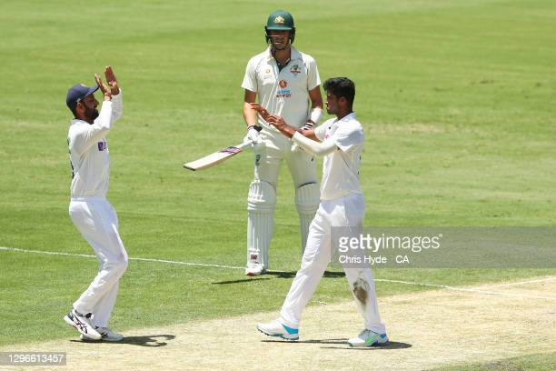 Washington Sundar of India celebrates after taking the wicket of Cameron Green of Australia during day two of the 4th Test Match in the series...