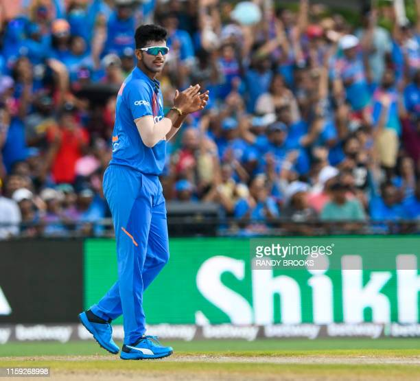 Washington Sundar of India celebrates the dismissal of John Campbell of West Indies during the 1st T20i match between West Indies and India at...
