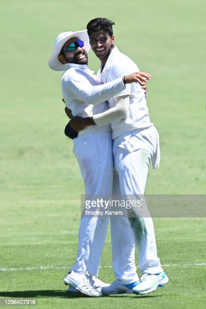 Washington Sundar of India celebrates with Rohit Sharma of India after dismissing Steve Smith of Australia during day one of the 4th Test Match in...