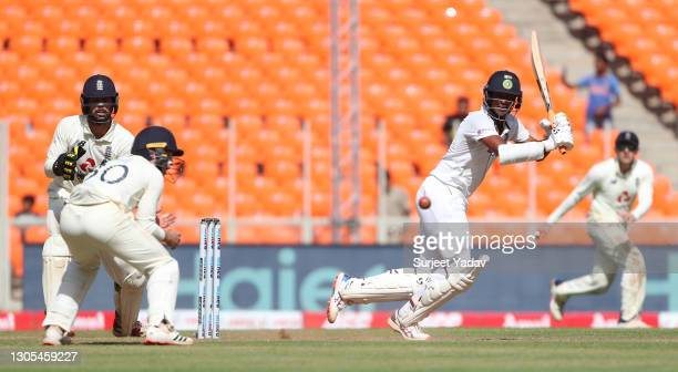 Washington Sundar of India hits runs watched on by Ben Foakes and Ollie Pope of England during Day Two of the 4th Test Match between India and...