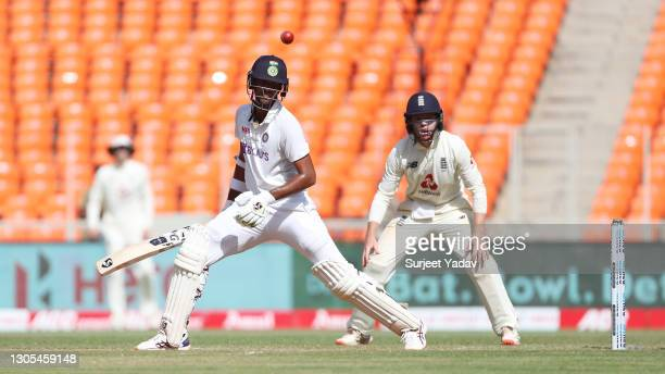 Washington Sundar of India hits runs watched on by Ollie Pope of England during Day Two of the 4th Test Match between India and England at Sardar...