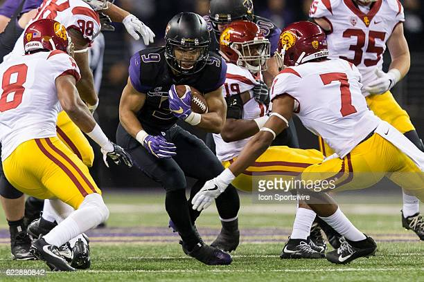 Washington tailback Myles Gaskin finds a crease in the USC defense during an NCAA football game between the USC Trojans and the Washington Huskies at...