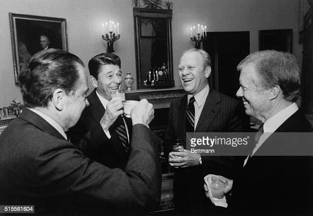 The White House released this photo 12/21 of President Reagan toasting with former Presidents Ford and Carter at the White House 10/8 before the...