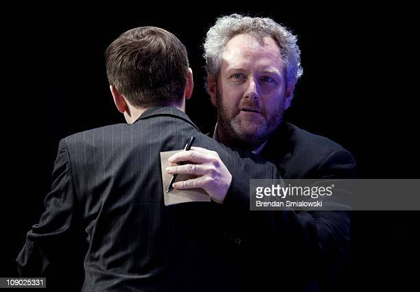 Washington Times commentator and Breitbartcom webmaster Andrew Breitbart hugs Guy Benson of Townhallcom before speaking during the final day of the...