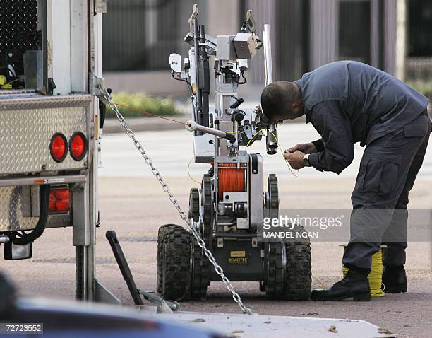 A bomb disposal technician prepares a robot before sending it off to a building on Pennsylvania Avenue where a suspicious package was found near the...