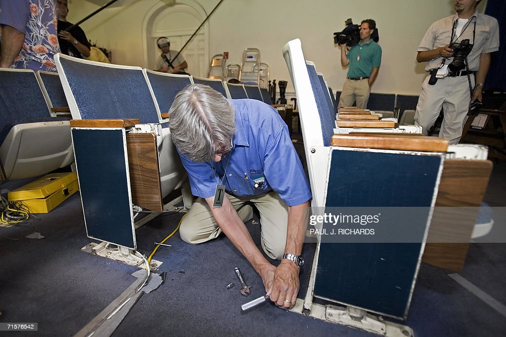 A General Services Administration (GSA) employee starts the process of removing everything from the White House Press Room by unbolting the theatre chairs from the floor 03 August, 2006. The run-down press room will take nine months to remodel and bring it into the 21st century. AFP Photo/Paul J. Richards