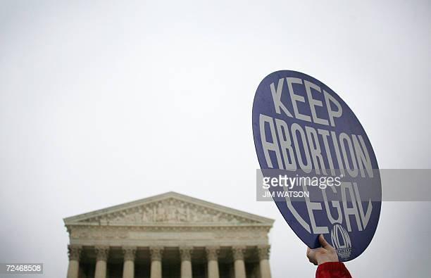 A prochoice demonstrator holds up a placard outside the US Supreme Court in Washington DC 08 November 2006 as the court hears oral arguments in the...
