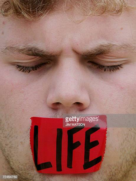 A prolife demonstrator protests outside the US Supreme Court in Washington DC 08 November 2006 as the court hears oral arguments in the partialbirth...