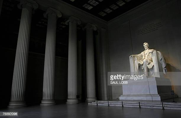 A statue of former US President Abraham Lincoln looks out over the National Mall from the inside of the Lincoln Memorial in Washington DC 21 July...