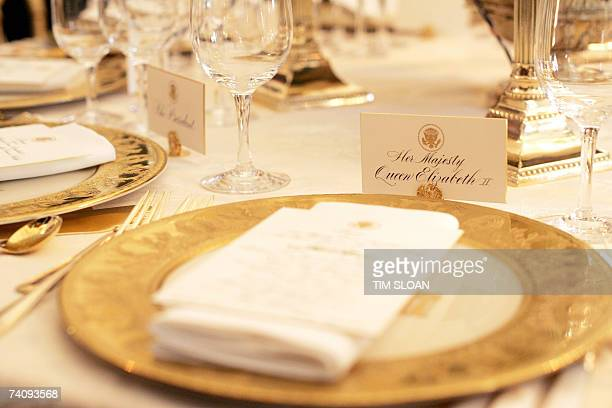Washington, UNITED STATES: A table setting is shown during a press preview of the State dinner for Queen Elizabeth II of England and her husband...