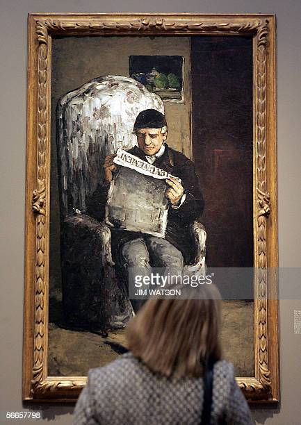 Washington, UNITED STATES: A woman looks at 'The Artist's Father, Reading L'Evenement' by French artist Paul Cezanne during the press preview of...