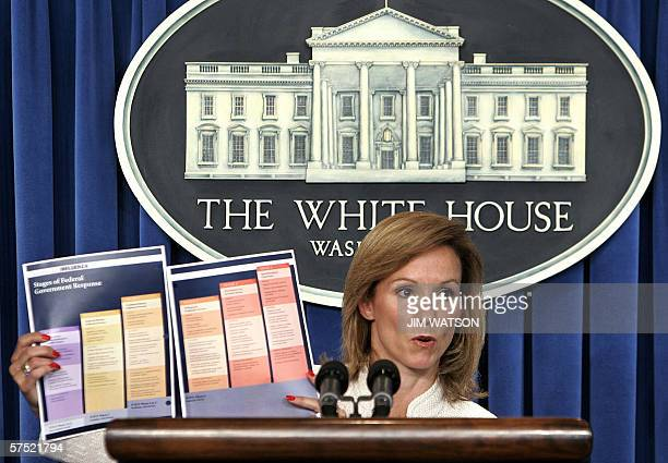 Assistant to the US President for Homeland Security and Counterterrorism Fran Townsend holds up a graph showing the Stages of the Federal Government...