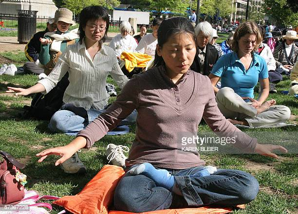 Falun Gong practitioners meditate 19 April 2006 in McPherson Square park in Washington DC Ahead of the official visit by Chinese President Hu Jintao...
