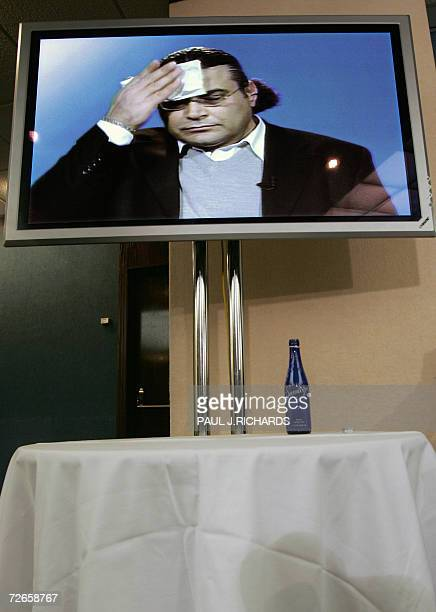 FILES Picture taken 06 December 2005 during a press conference at the National Press Club in Washington DC shows German citizen Khaled ElMasri wiping...
