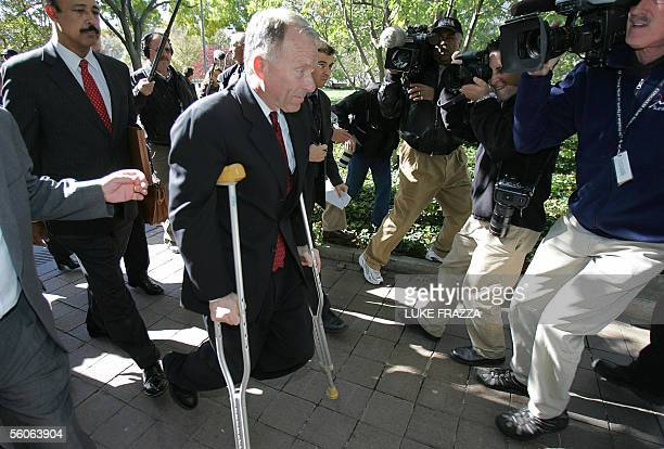 Former Chief of Staff for US Vice President Dick Cheney I Lewis Scooter Libby is surrounded by members of the media as he walks out of US District...