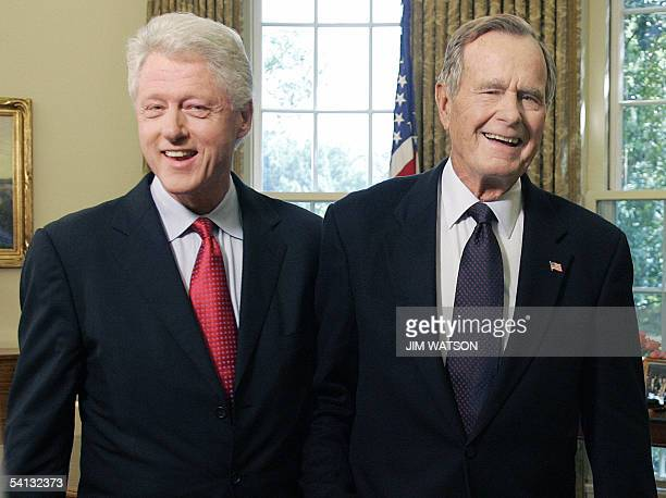 Former US Presidents George HW Bush and Bill Clinton smile as they leave the Oval Office 01 September 2005 at the White House in Washington DC The...