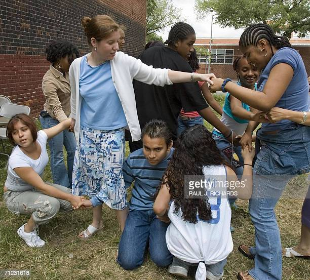GRADUATES MOVE FROM HARVARD AND YALE TO INNER CITY SCHOOLS Teacher Jennifer Kirmes works with students after tying themselves in a group handtohand...