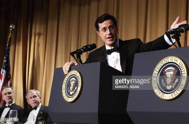 Guest host Comedy Central's 'newsman' Stephen Colbert gestures during a performance as US President George W Bush and Tom Curley of the Associated...