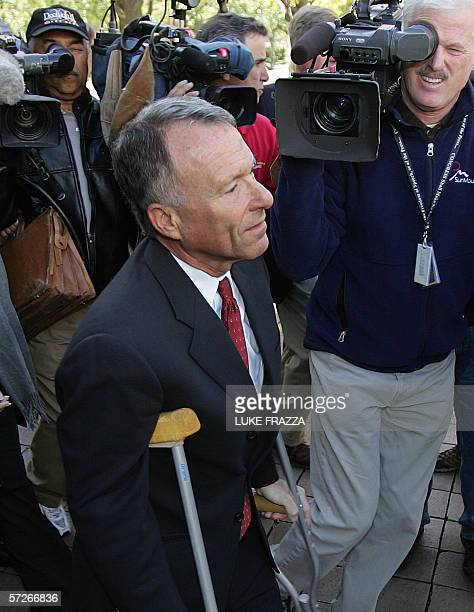 In this 03 November file photo former Chief of Staff for US Vice President Dick Cheney I Lewis Scooter Libby is surrounded by members of the media as...