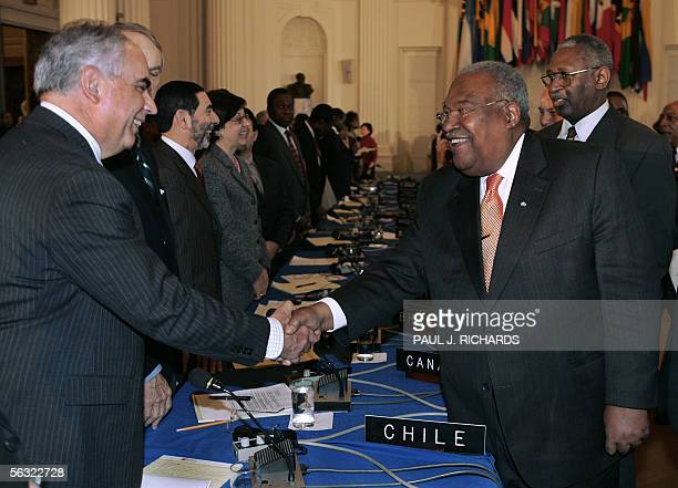 Washington, UNITED STATES: Interim Haitian Prime Minister Gerard Latortue shakes hands with the Organization of American States Representative from...