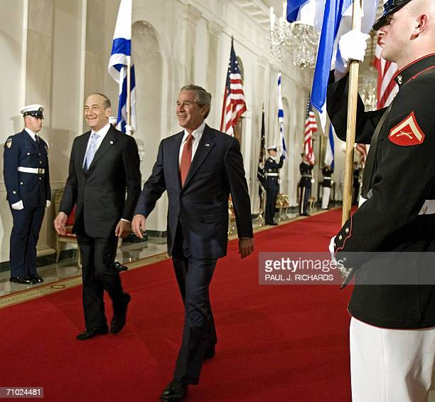 Israeli Prime Minister Ehud Olmert and US President George W Bush walk through Cross Hall of the White House on their way to conduct a joint press...