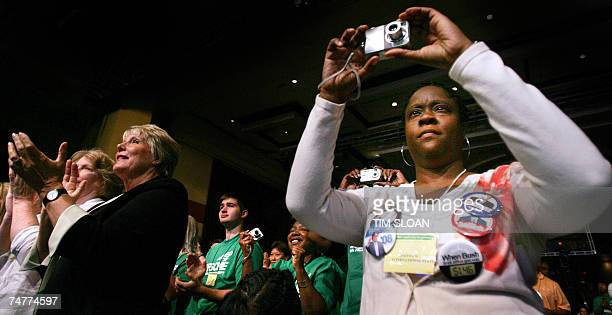 Jakeda Scott takes a photograph of a US Democratic presidential candidate during the American Federation of State County and Municipal Employees...