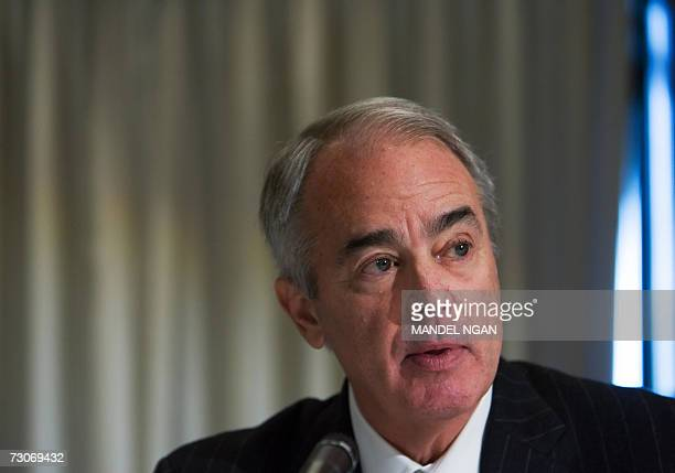 Washington, UNITED STATES: Jim Rogers, Chairman, President and CEO of Duke Energy, speaks during a press conference organized by the US Climate...