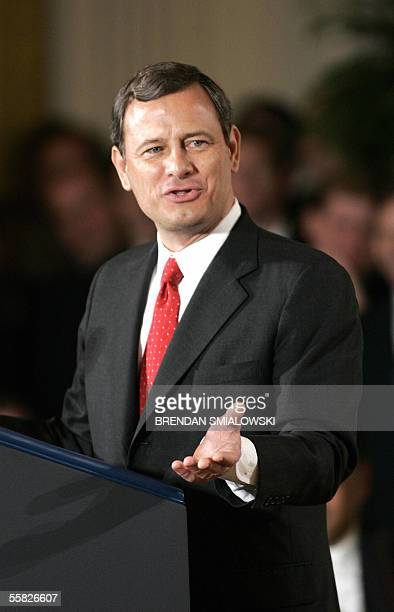 Washington, UNITED STATES: John Roberts speaks during a ceremony in the East Room of the White House 29 September 2005 in Washington, DC, after he...