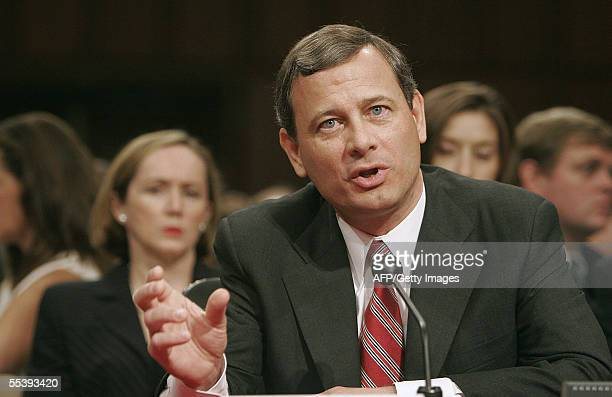 Judge John Roberts answers a question 13 September 2005 as his wife Jane listens during the second day of his confirmation hearings before the Senate...