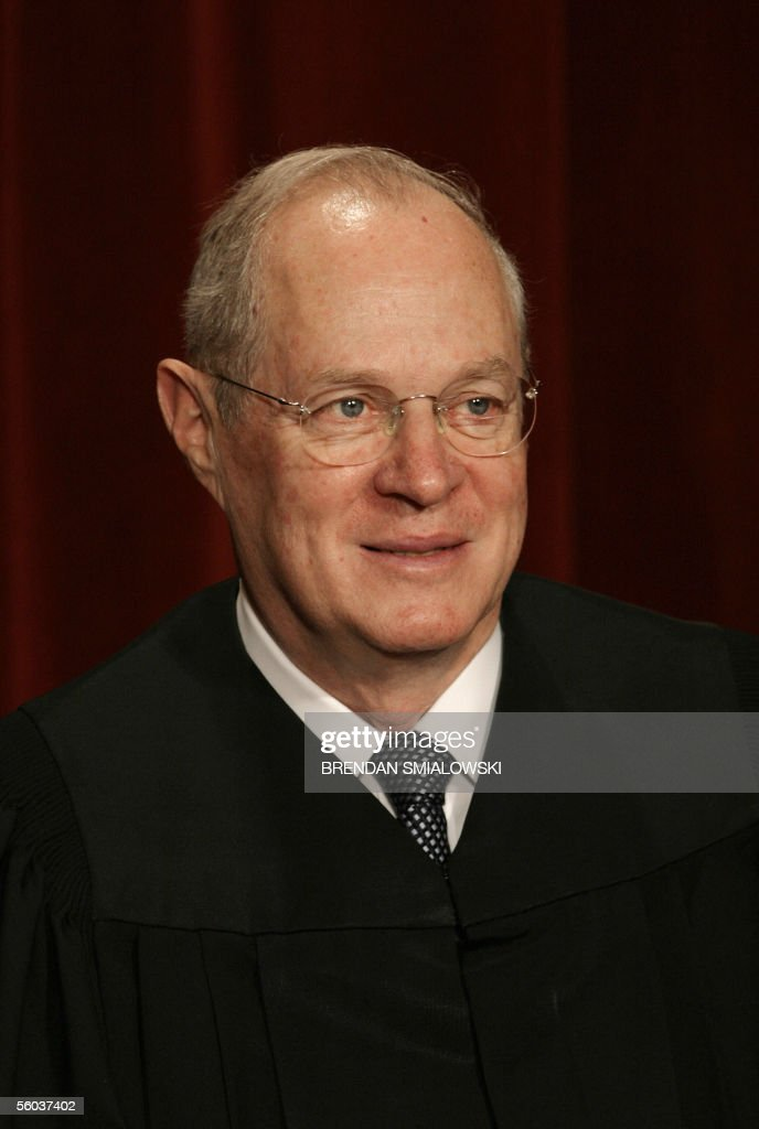 Justice Anthony Kennedy sits for a class photo at the Supreme Court 31 October, 2005 in Washington, DC. The Justices sat for their picture for Chief Justice Roberts's first class photo. AFP PHOTO/Brendan SMIALOWSKI