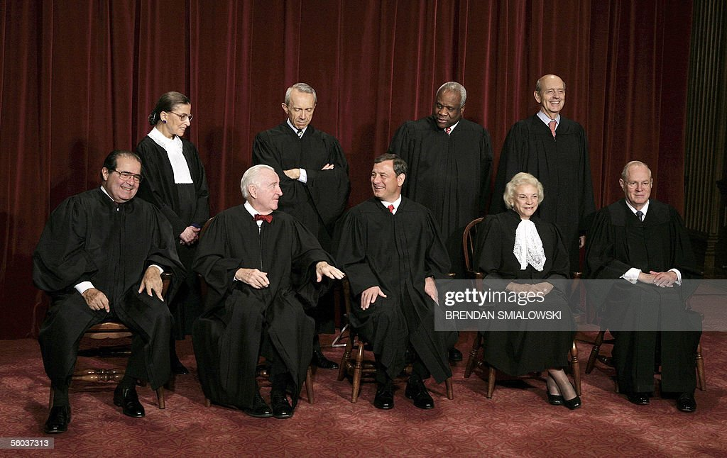 Justices of the US Supreme Court justices posing for their class photo 31 October, 2005 at the Supreme Court in Washington, DC. Seen in this image are: (First Row L-R) Justice Antonin Scalia, Justice John Paul Stevens, Chief Justice John G. Roberts, Justice Sandra Day O'Connor, Justice Anthony M. Kennedy, (Second Row L-R) Justice Ruth Bader Ginsburg, Justice David H. Souter, Justice Clarence Thomas and Justice Stephen G. Breyer. Earlier 31 October US President George W. Bush nominated judge Samuel Alito to replace Sandra Day O'Connor who is retiring once her replacement is confirmed by the Senate. AFP PHOTO/Brendan SMIALOWSKI
