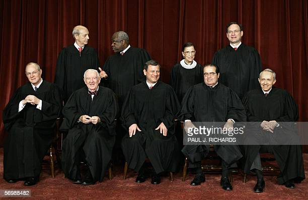 Justices of the US Supreme Court pose for their class photo 03 March 2006 inside the Supreme Court in Washington DC Front from left are Anthony...