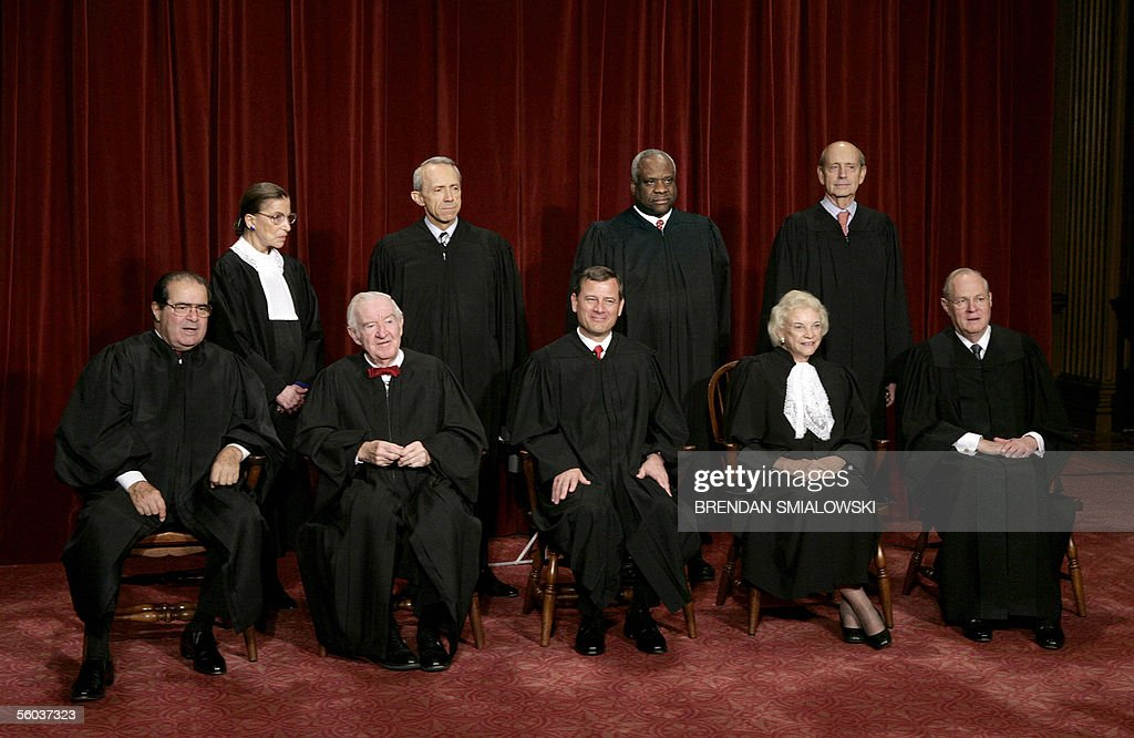 Justices of the US Supreme Court posing for their class photo 31 October, 2005 at the Supreme Court in Washington, DC. Seen in this image are: (First Row L-R) Justice Antonin Scalia, Justice John Paul Stevens, Chief Justice John G. Roberts, Justice Sandra Day O'Connor, Justice Anthony M. Kennedy, (Second Row-Standing L-R) Justice Ruth Bader Ginsburg, Justice David H. Souter, Justice Clarence Thomas and Justice Stephen G. Breyer. Earlier 31 October US President George W. Bush nominated judge Samuel Alito to replace Sandra Day O'Connor who is retiring once her replacement is confirmed by the Senate. AFP PHOTO/Brendan SMIALOWSKI