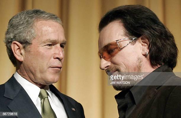 Lead Singer of the Irish rock group U2 Bono speaks with US President George W Bush during the National Prayer Breakfast in Washington DC 02 February...