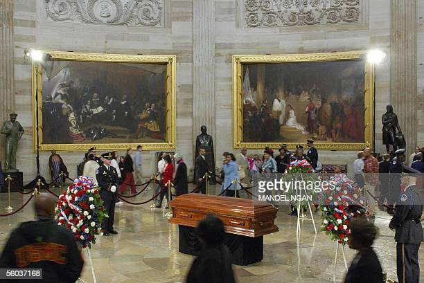 Mourners file past the casket of Rosa Parks as it lies in honor in the Rotunda of the US Capitol 31 October 2005 in Washington DC Parks hailed as the...
