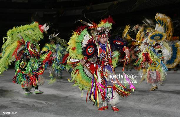 Native Americans dance as the National Pow Wow gets started 12 August 2005 at the MCI Center in Washington DC Representatives from many of America's...