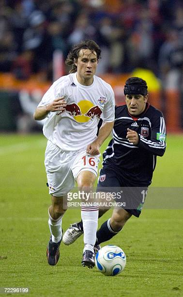 New York Red Bulls's Todd Dunivant moves the ball away from DC United's Alecko Eskandarian during the second half of the second leg of the DC United...
